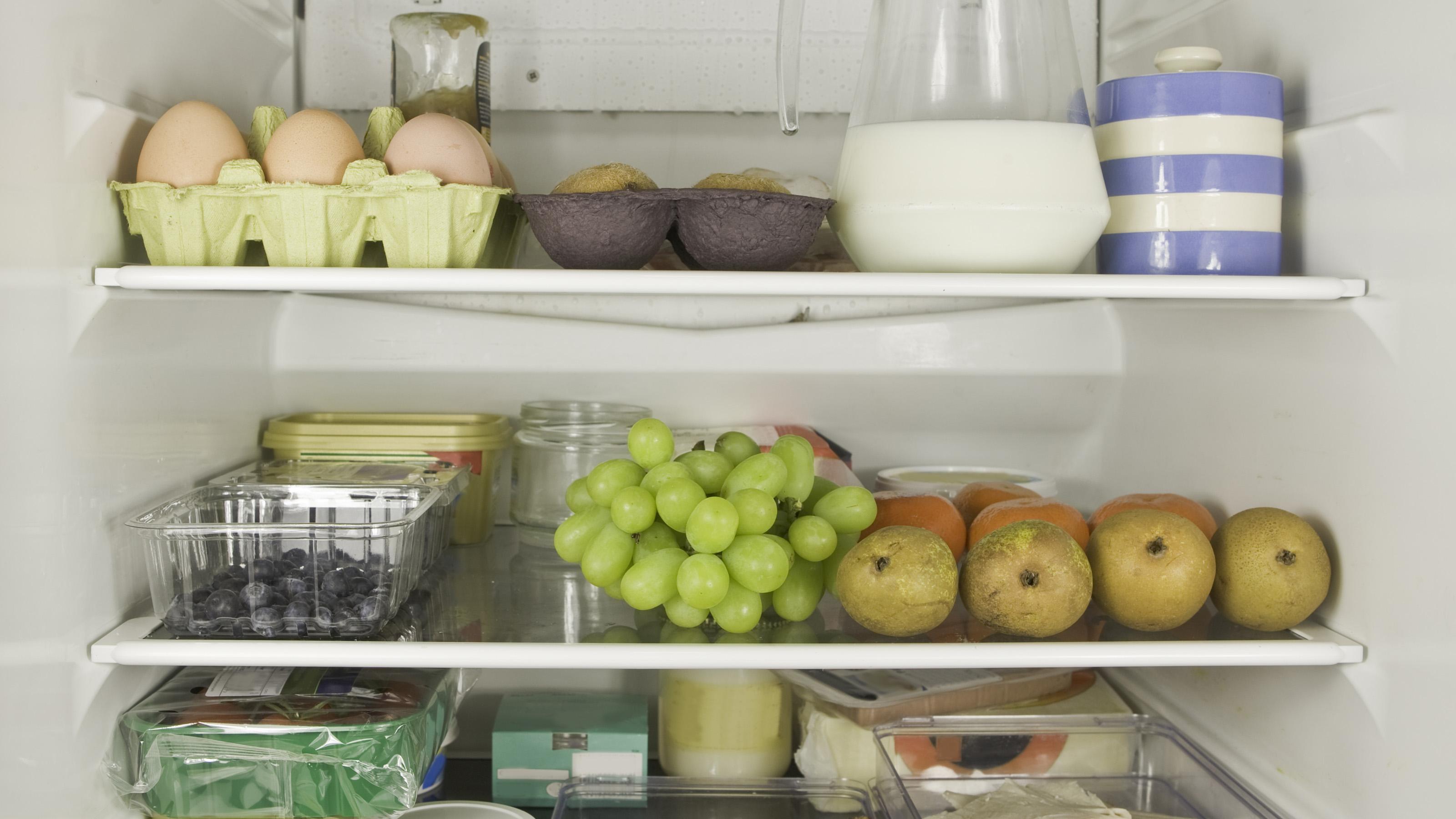 Three refrigerator shelves full of food