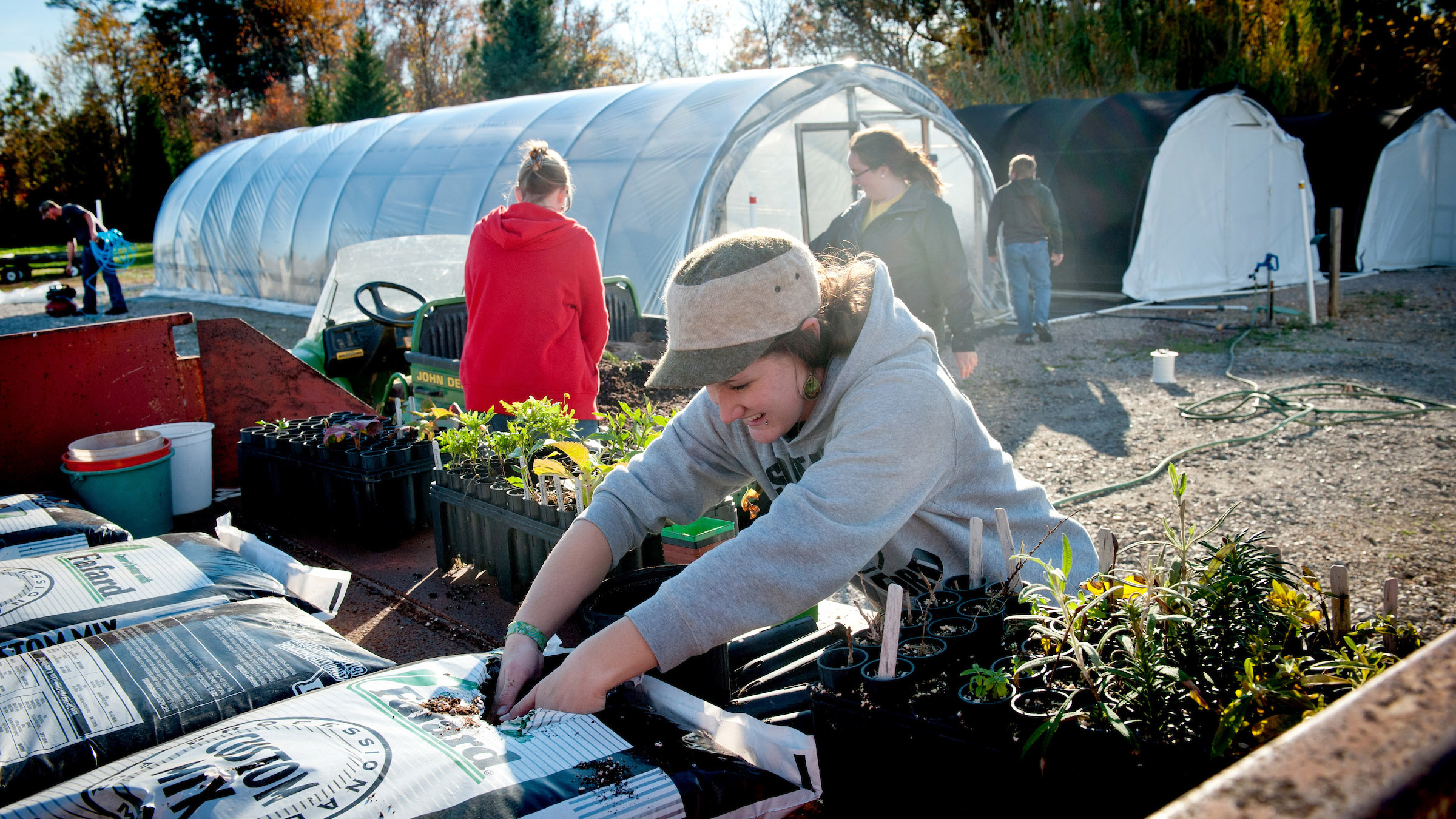 A woman gains hands-on gardening experience potting plants at NC State University's J.C. Raulston Arboretum in Raleigh, N.C.