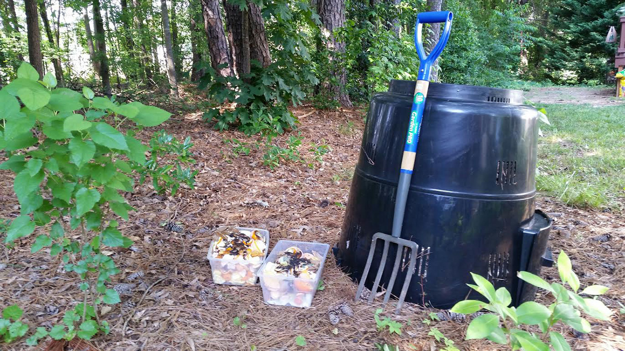 Materials used for composting, including a rain barrel, pitchfork and leftover produce, are collected together