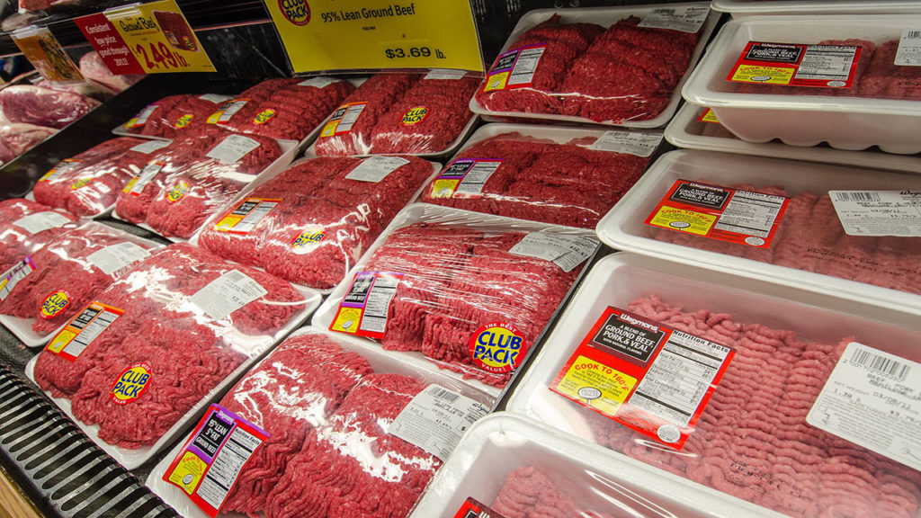 Frozen meat products at a grocery store.