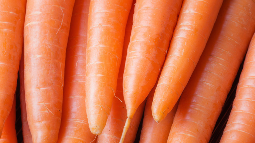 A close-up photo of clean carrots